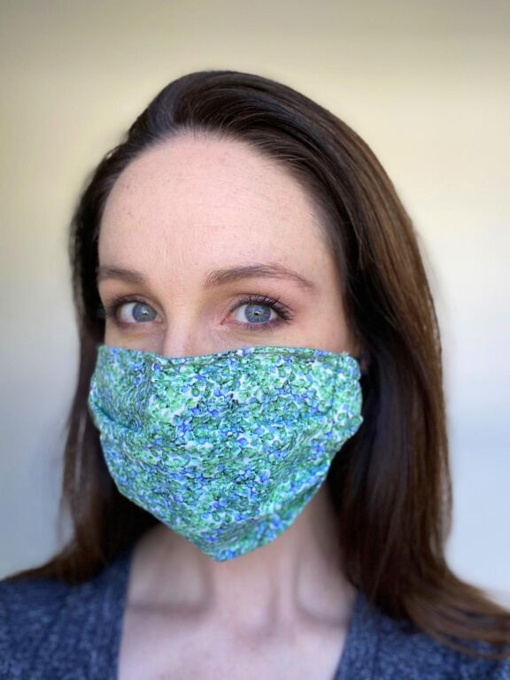 "NYC-based actor Laura Hall models PTC's ""green floral"" face mask. Photos courtesy of Laura Hall."